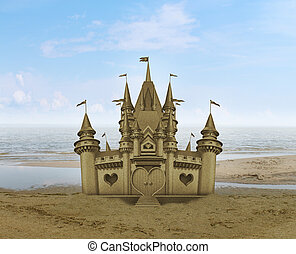 Sandcastle sculpture sand art on a relaxing sandy beach with...