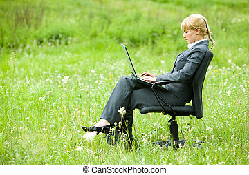 Work on open air - Photo of serious businesswoman sitting on...