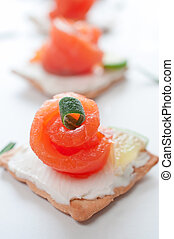 Canapes with smoked salmon and cream cheese close up