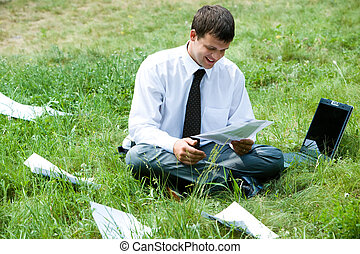 Deliberation - Photo of smiling businessman holding document...