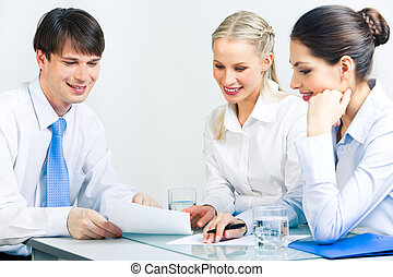 Business conversation - Portrait of three business people...