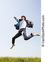 Creative jump - Photo of businessman in suit jumping on the...