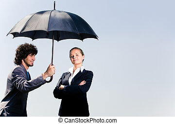 Safety - Image of confident business man holding umbrella...