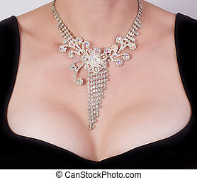 Woman breast with jewelry