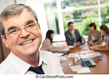 Face of businessman - Photo of confident businessman with...