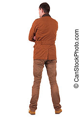 Back view of stylishly dressed man in a brown jackett...