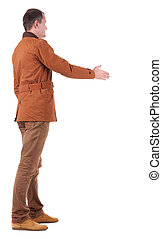 back view of businessman in movement reaches out to shake...