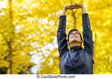 Arms up for stretching outside - Beautiful sport fitness...