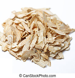 Angelica root slices isolated on a white and plain...