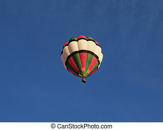 Hot air baloon in blue sky