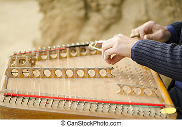 Cymbalo Sound in Nature - An artist playing the dulcimer in...