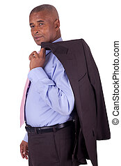 African American business man with coat over shoulders on...