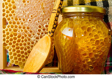 Jars of honey and honeycomb. Honey products