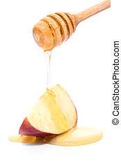 Stick with honey dripping on red apple isolated on white