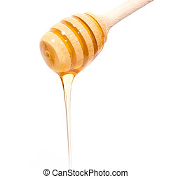 Stick with honey isolated on white