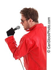 Rock Star Man with a microphone, wearing a red leather...