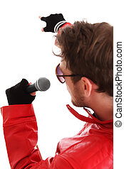 Rock Star pointing Holding a microphone Wearing a red...