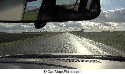 autumn asphalt road after rain and inside car