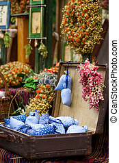 Dried wild flowers and handmade decor in old fashioned...