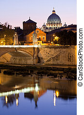 Saint Peter's Basilica Rome Italy on Tiber bank in evening -...