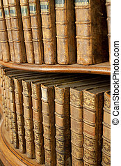 Covers of old medieval literary books on shelves in bookcase...