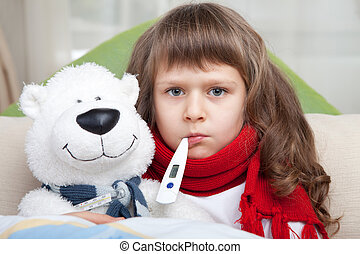 Little sick girl with thermometer embraces toy bear in bed -...