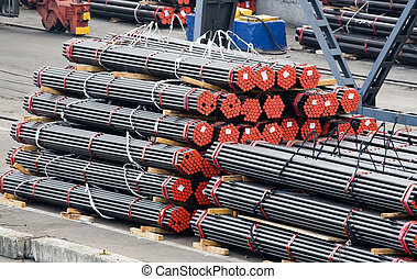 Stack of metal bars prepared for loading - Stack of metal...