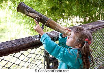 Little inquisitive girl preschooler discovers surroundings...