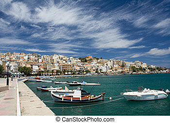 Sea bay, promenade in Mediterranean town and cirrus clouds -...
