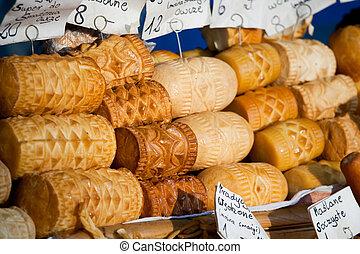 Smoked cheese Oscypki on the market in Zakopane Poland -...