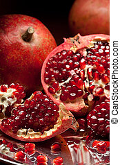 Pomegranate slices and seeds on silver tray - Pomegranate...