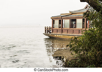 Travel Boat on West Lake - Chinese Travel boat next to...