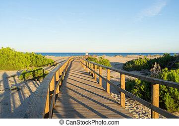Carabassi footbridge. - View of Carabassi beach footbridge.