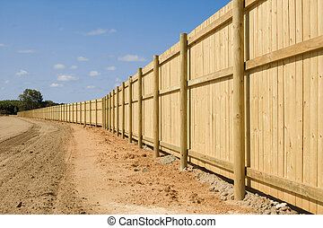 fence - a long new fence on new property development