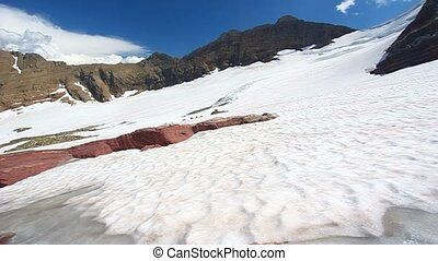 Sperry Glacier in Montana - Snow and glacial rock at the...