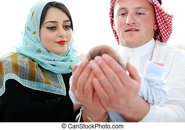 Arabic Muslim couple with new baby at home - Arabic Mother...