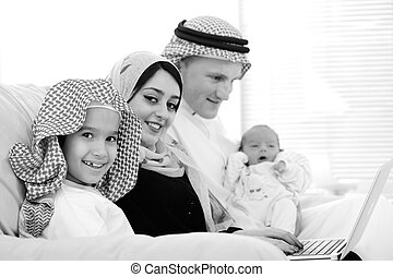Young family with new baby at home