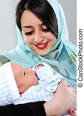 Arabic woman with her baby