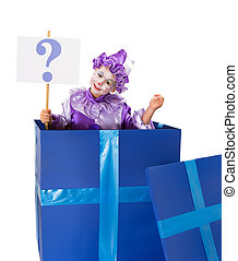 Question mark surprise - Young girl clown popping out of a...