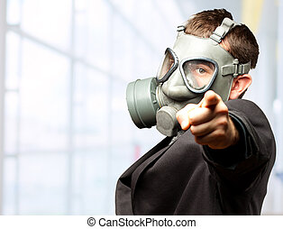 Businessman Pointing With Gas Mask, indoor