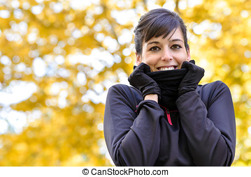 Cold training in fall - Beautiful sport woman with scarf...