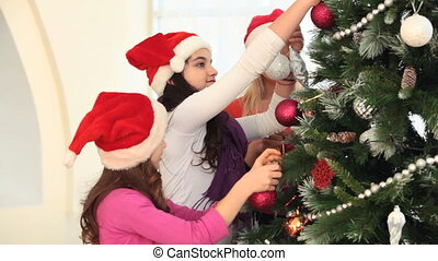 New Year motherhood - Mother and daughters decorating...