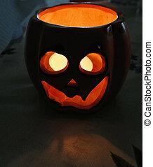 Jack-o-lantern - Jack-O-Lantern with lit candle inside in...