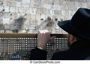 Man looking at the Westen - Man looking at the Western Wall,...