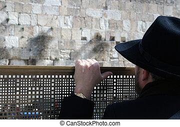 Man looking at the Westen - Man looking at the Western Wall,...