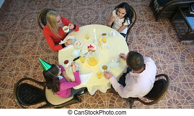 Sweet family life - Family of four sitting at one table and...