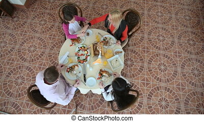 In dining room - The above-view of a happy family dining at...