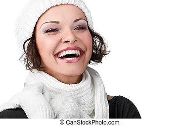 beautiful young girl in her winter warm clothing on white...