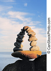 Poise - Arch of pebbles in balancing on the seacoast