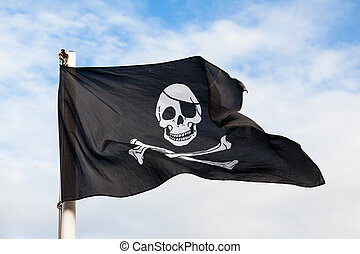 Waving Pirate flag isolated on blue sky
